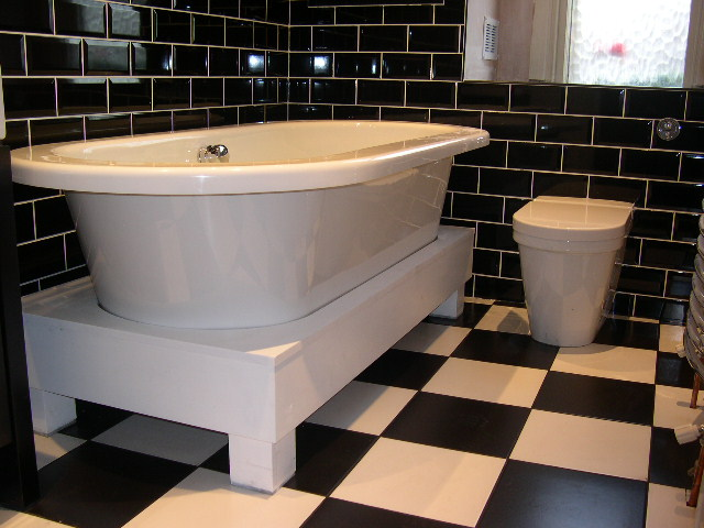 black and white tiled bathroom. A lack and white bathroom