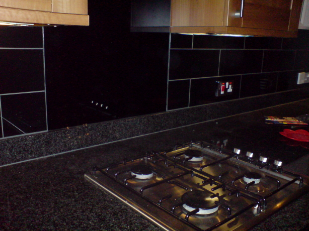 These are the black glass tiles. Not a great picture but you try taking one